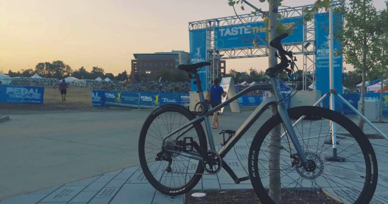 Bike in front of pedal the cause finish line