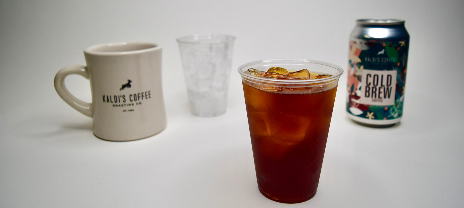 Kaldi's Cold Brew Line Up - A can of cold brew coffee with a mug and a plastic cup