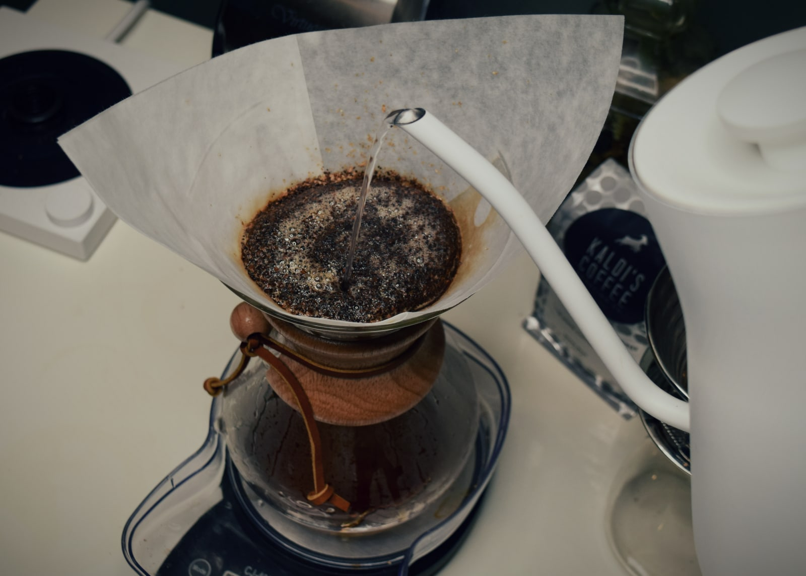Pouring over a Chemex coffee bed
