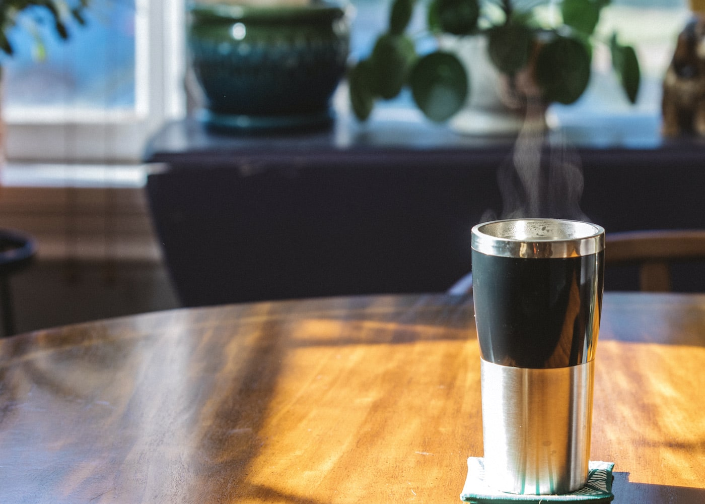 Hot coffee in a stainless steel tumbler