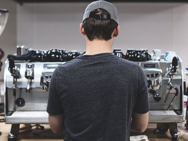 Performing Espresso Coffee Quality Control at our St. Louis Roastry, standing at our Black Eagle espresso machine