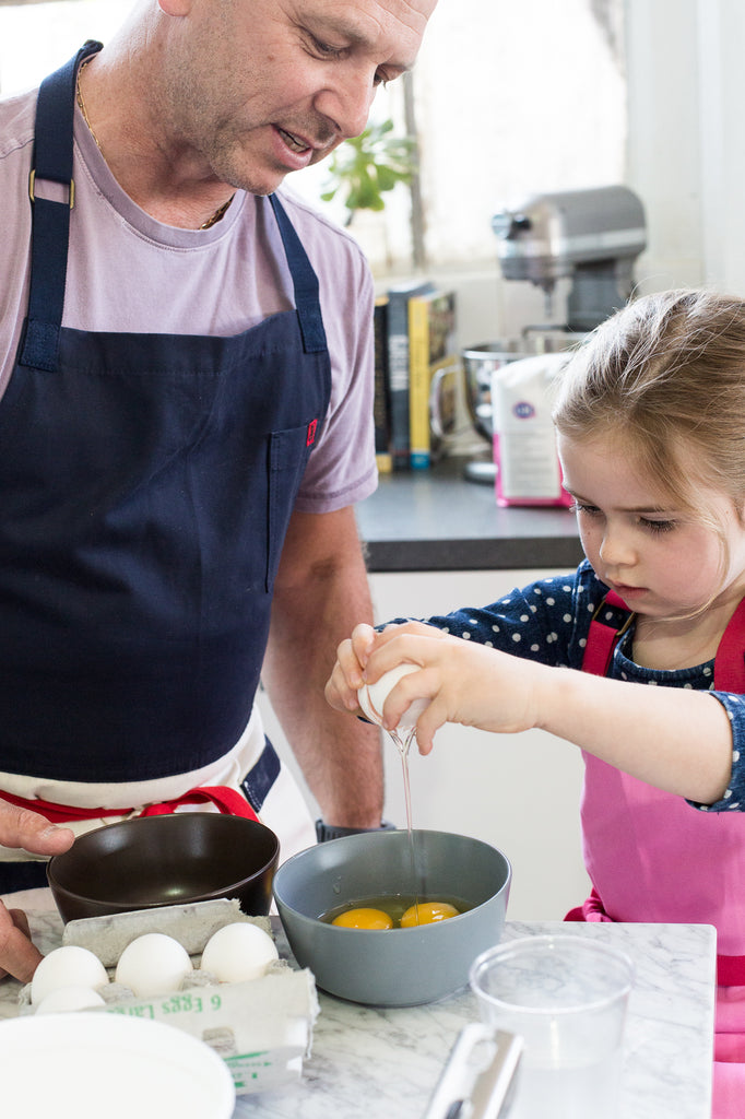 Eloise breaks some eggs with her dad, Chef Cyrille Pannier