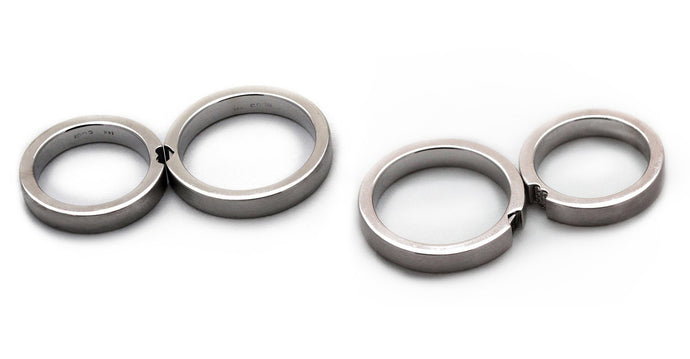 Two white gold promise rings for couples with diamonds