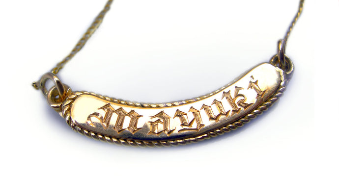 gold hip hop name bar necklace in yellow gold and handmade engraving