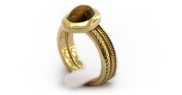 gold or silver Tiger-eye cabochon-cut stone filigree ring