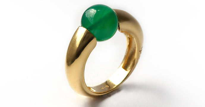 Green solitaire with rose gold combination ring donut