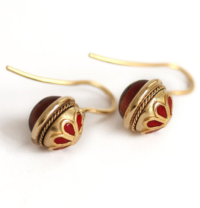 Vintage looking earrings with a red Cornelian stone ball