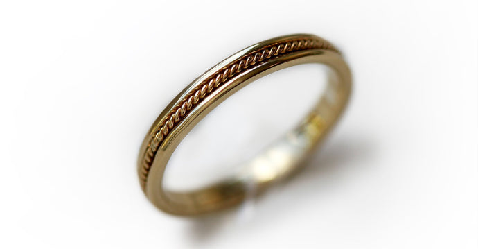 yellow gold twist male wedding band with braided filigree