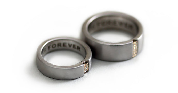 Two engraved heart rings set in silver with diamonds