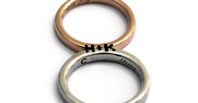 rose gold and silver promise ring set engraved with initials