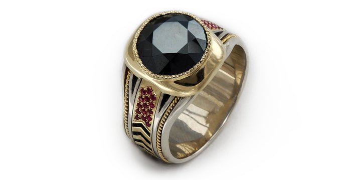 black Spinel gemstone on yellow and white gold with red Rubies ring