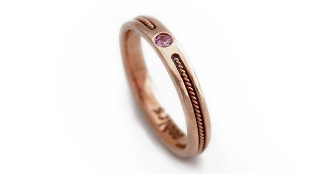 rose gold ring embedded with pink Sapphire gemstone