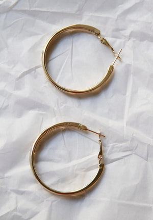 Three tier gold hoop earrings.