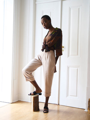 Beige Tapered Capri Trousers