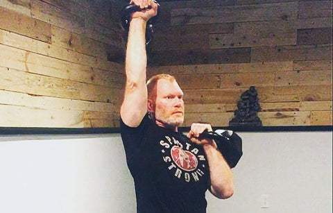 Todd working out with Kettlebells