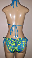 Tie back halter swimwear top. Tie hips bikini bottom.