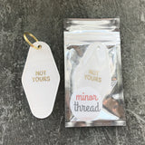 Not Yours Motel Key Tag in White with Gold Foil