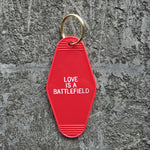 Seconds Sale: Love Is A Battlefield Hotel Key Tag in Red