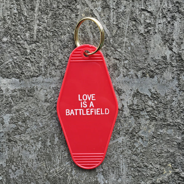 Love Is A Battlefield Hotel Key Tag in Red