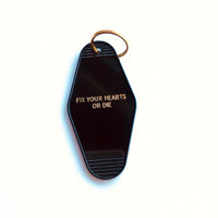 Twin Peaks Fix Your Hearts or Die Motel Key Tag in Black and Gold