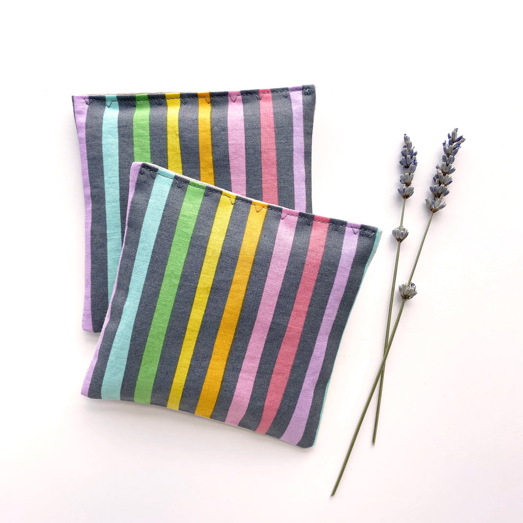 Fragrant Lavender Sachet Made of a Silk Striped Pastel Fabric Wrapped with a Satin Pastel Violet Ribbon and Secured with a Violet Button