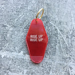 Seconds Sale: Rise Up Rise Up Key Tag in Translucent Red Revolution
