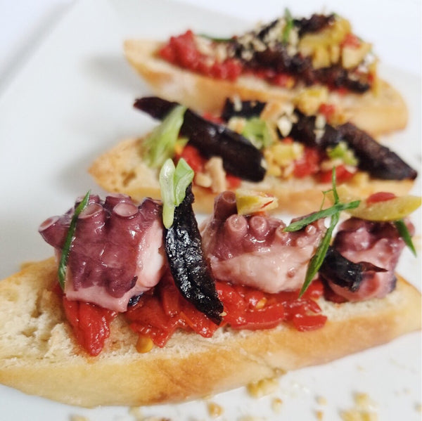 Chef Andy Suarez: Pan Rustico with Octopus in Olive Oil, Piquillo Peppers, & Cantabrian Anchovies