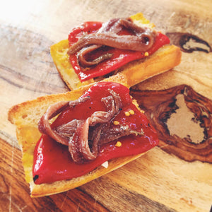 Cantabrian anchovies with piquillo peppers on garlic toast