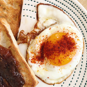 Piment d'Espelette on fried egg cooked in EVOO - Donostia Foods