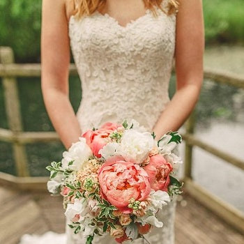 Bride In Lace Dress With Coral Bouquet