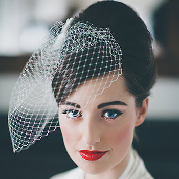 1950s Wedding Hairstyle With Birdcage Veil
