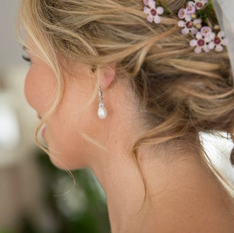 bride wears Beverly earrings