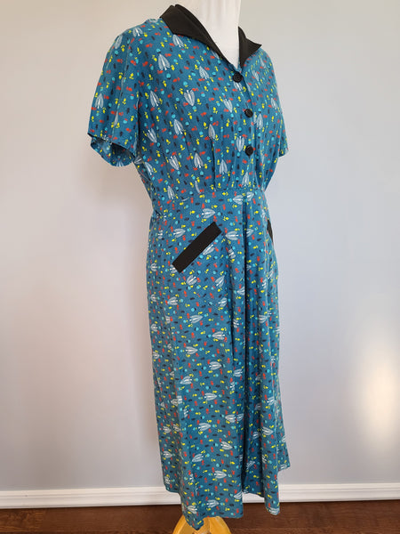 "Teal Leaf Print Dress <br> (B-40"" W-31"" H-41"")"