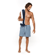 Load image into Gallery viewer, Male holding beach towel wearing Houndstooth Swimwear Short