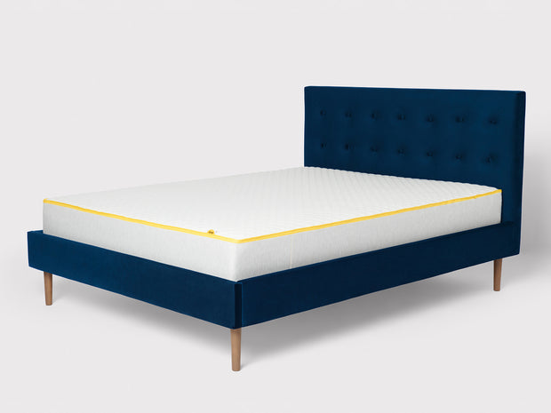 the button back bed frame