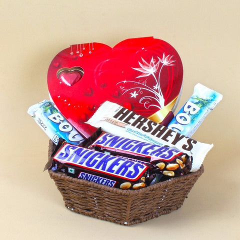 Basket full of Hershey's and Snickers with Heart shape Chocolate box