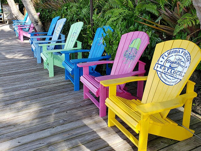Adirondack chairs along the river at Guanabanas Restaurant and Bar in Jupiter Florida - perfect location for Docktails