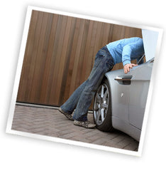 Image of someone looking under a car to show you can't look inside of an organic mattress