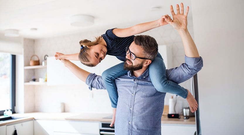 Dad with daughter on his shoulders