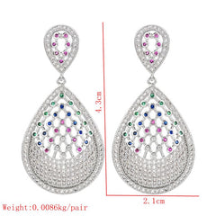Platinum plated earrings with small white and colored round zirconia