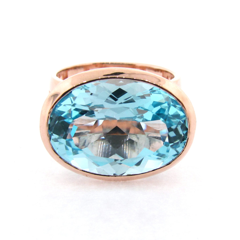 Rose Gold Blue Topaz Horizon Ring