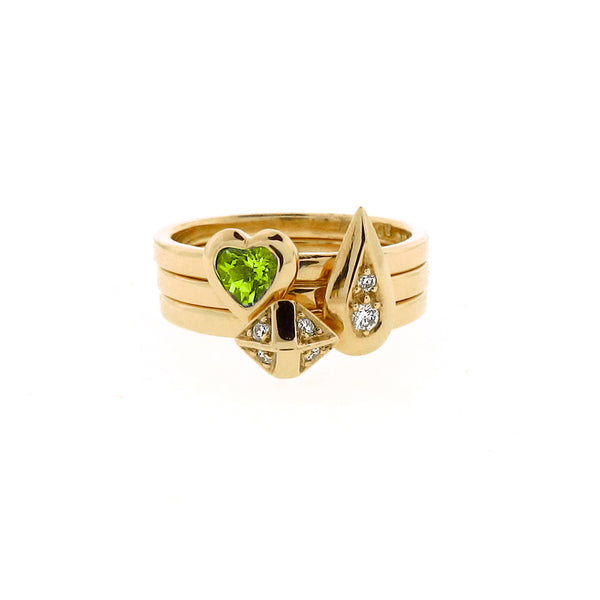 yellow gold diamond peridot ring stacking set