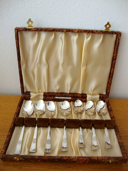 7 small teaspoons from England, in original box