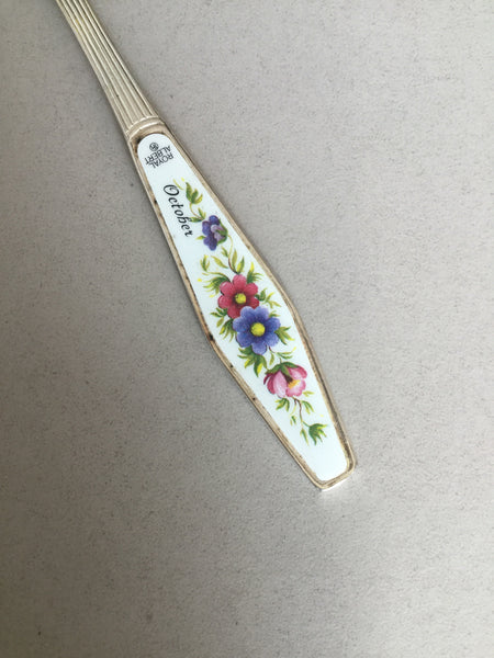 ".Small spoon with flowers on handle and ""October"""