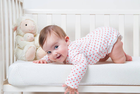 baby giggling on Numu-Roo mattress