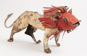 Lion animal sculpture in recycled metal from Zimbabwe. Animale métallique Zimbabwe  par Mahatsara.