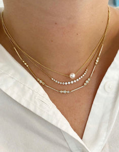Graduated Single Prong Diamond Necklace