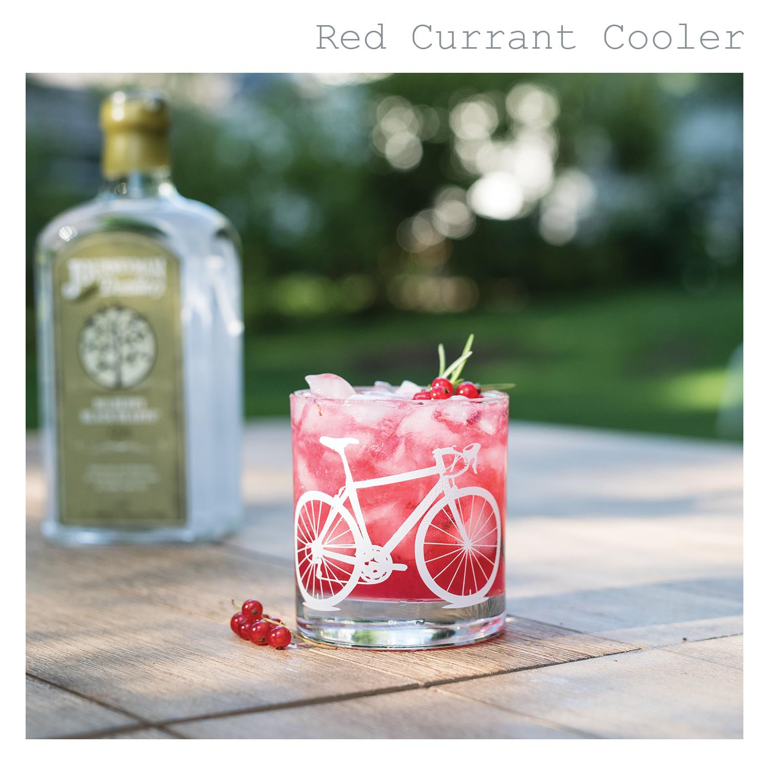Non alcoholic red currant cooler in white bicycle rocks glass