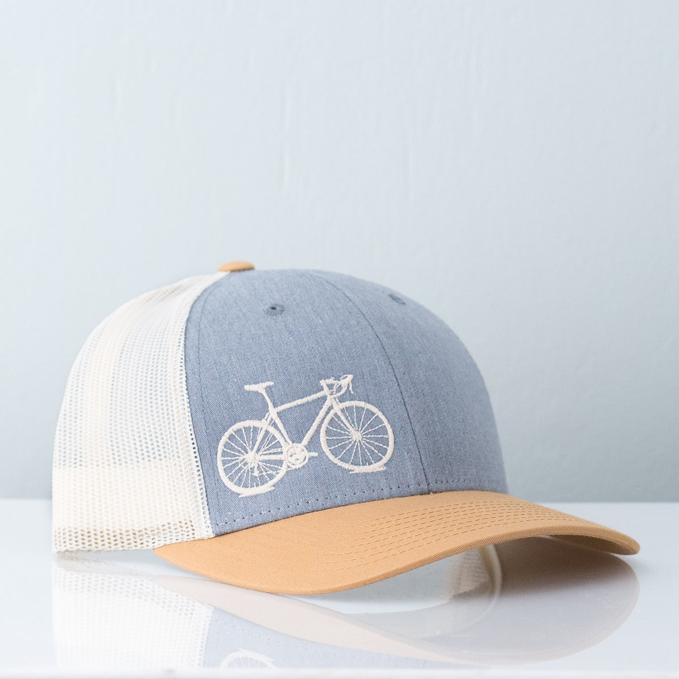 Birch mesh back trucker hat embroidered with cream vital bicycle