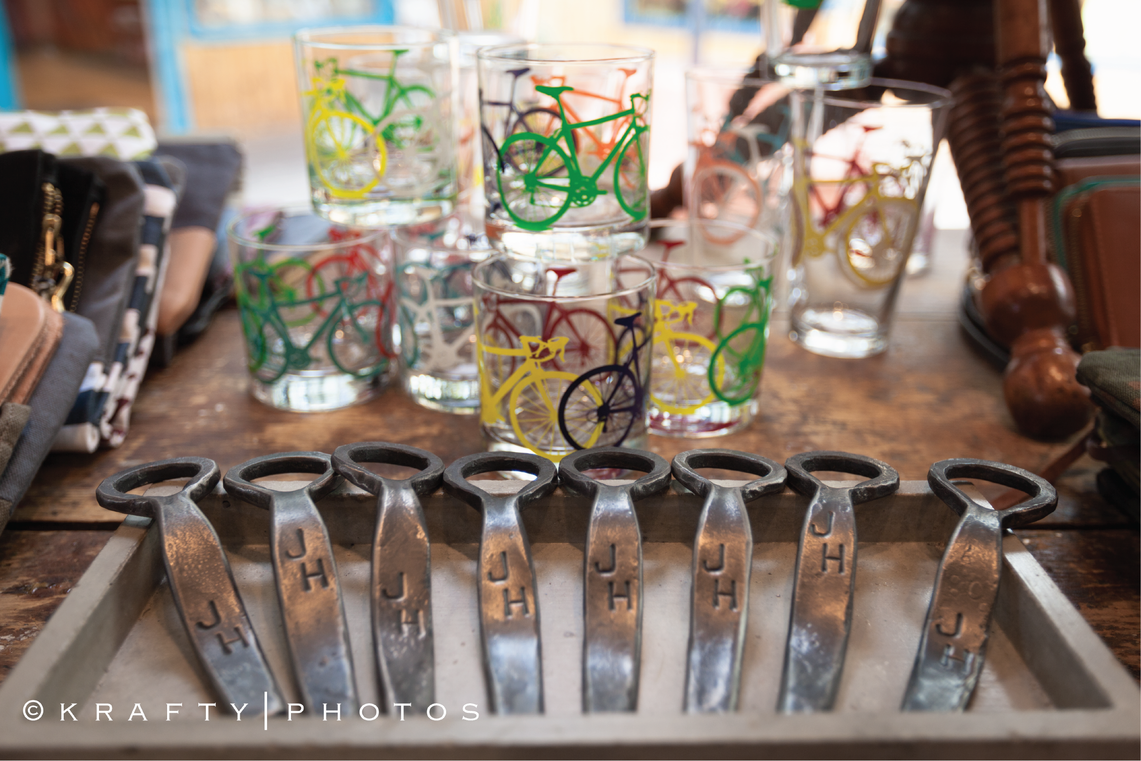 Close up of bicycle glassware and can opener on store shelf